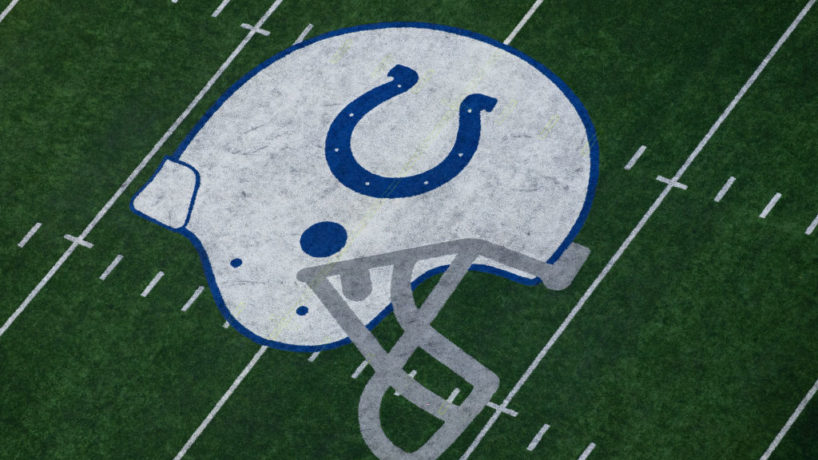 The Colts logo on the field.