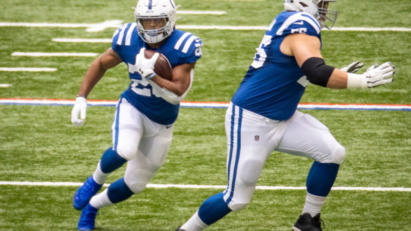 Jonathan Taylor runs passed a block courtesy of Quenton Nelson in the Colts win over Cincinnati