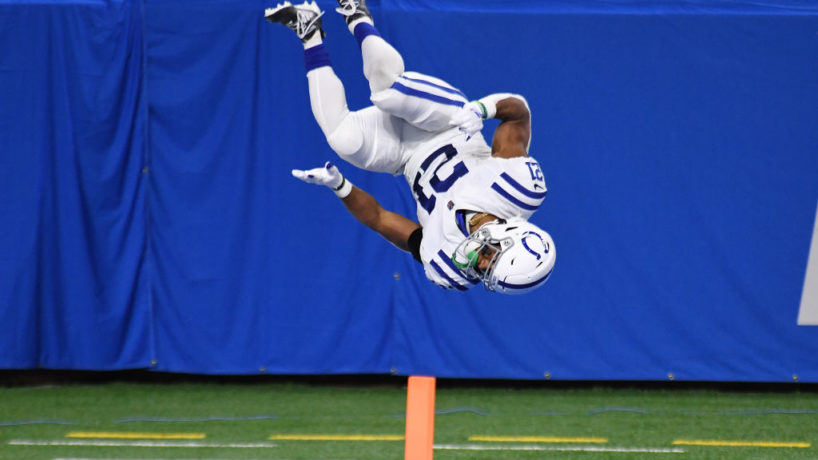 Colts running back Nyheim Hines flips after a touchdown.