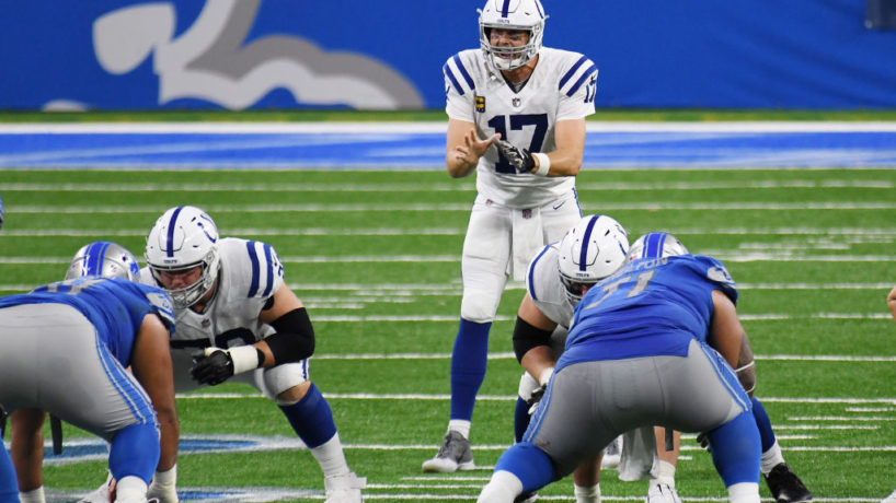 Philip Rivers behind his offensive line in the shotgun waits on the ball to be snapped in a game at Detroit