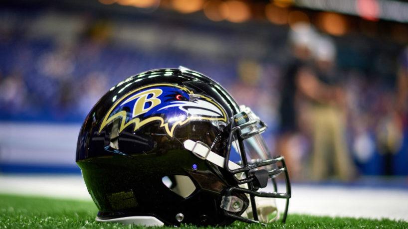 A Ravens helmet sits on the turf at Lucas Oil Stadium