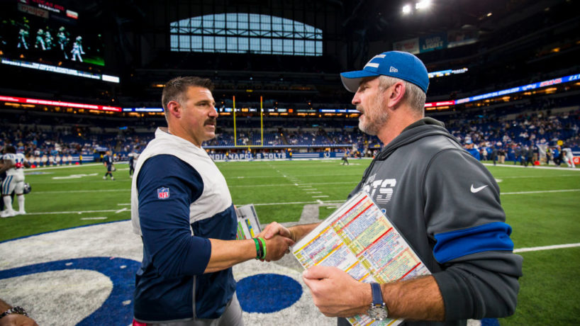 Head coaches Mike Vrabel and Frank Reich shake hands after a game.