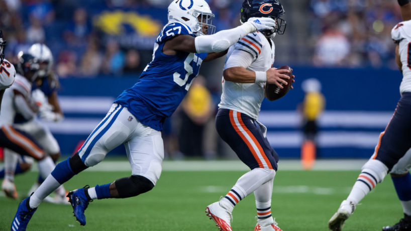 Colts DE-Kemoko Turay hits an opponent.