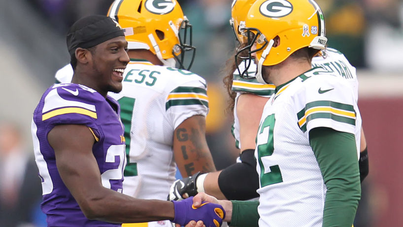Aaron Rodgers shakes hands with now Colts cornerback Xavier Rhodes when he was with the Vikings