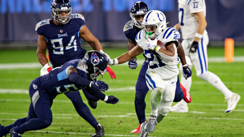Colts running back Nyheim Hines runs away.