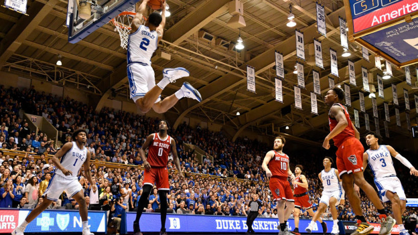 Cassius Stanley goes up for a dunk against North Carolina State with his opponents looking on