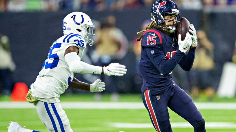 Houston Texans wide receiver Will Fuller catches a pass with a Colts defender coming to his left to tackle him
