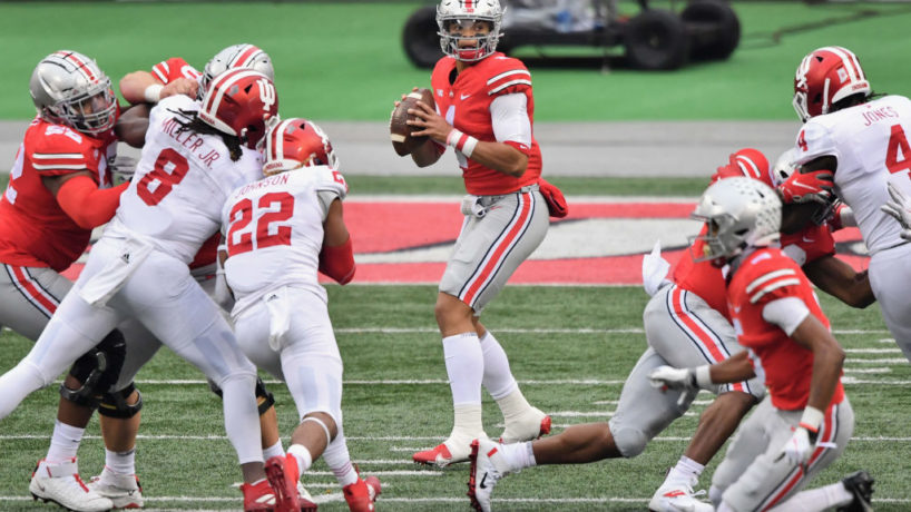 Ohio State Quarterback Justin Fields drops back to pass with the Ohio State offensive line protecting him from the Indiana Pass rush