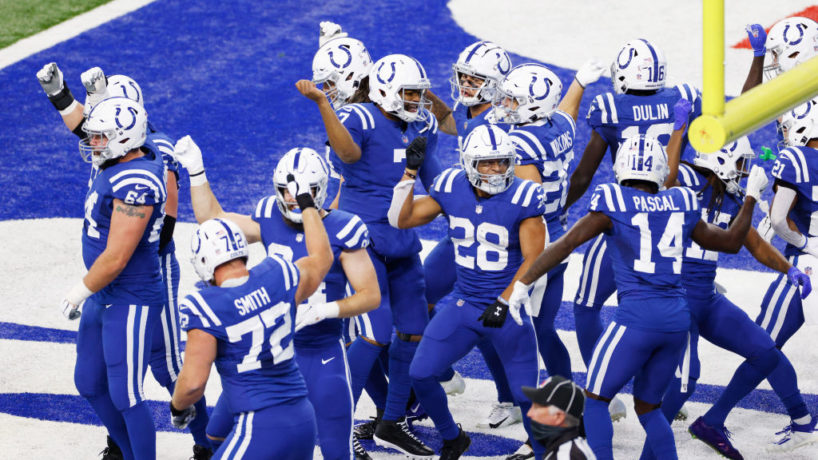 Colts players celebrate a touchdown.