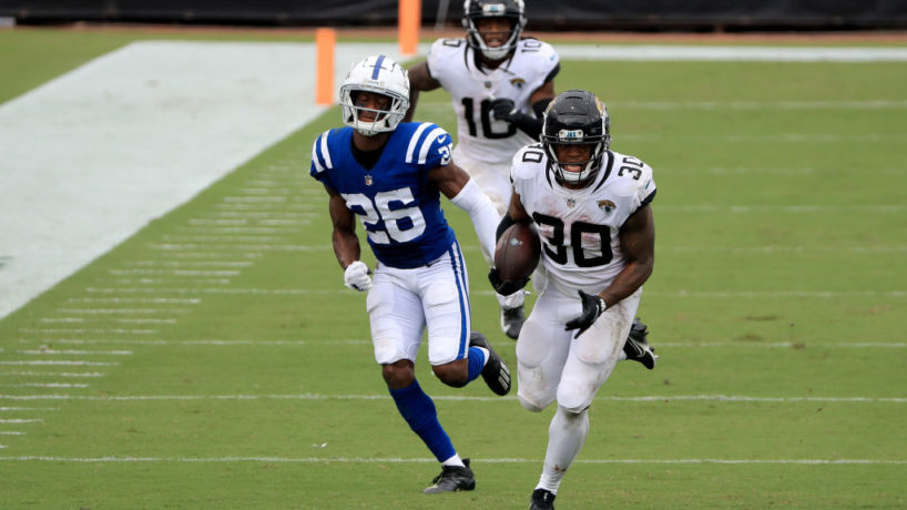 Colts player Rock Ya-Sin chases after Jaguars running back James Robinson.