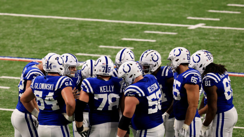 Colts offense gathers for a huddle.