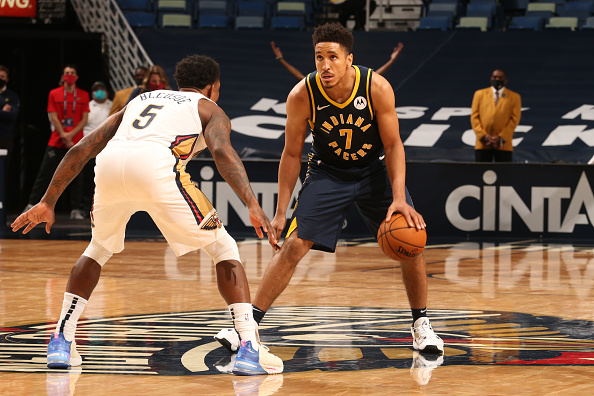 Pacers guard Malcolm Brogdon dribbles out front.