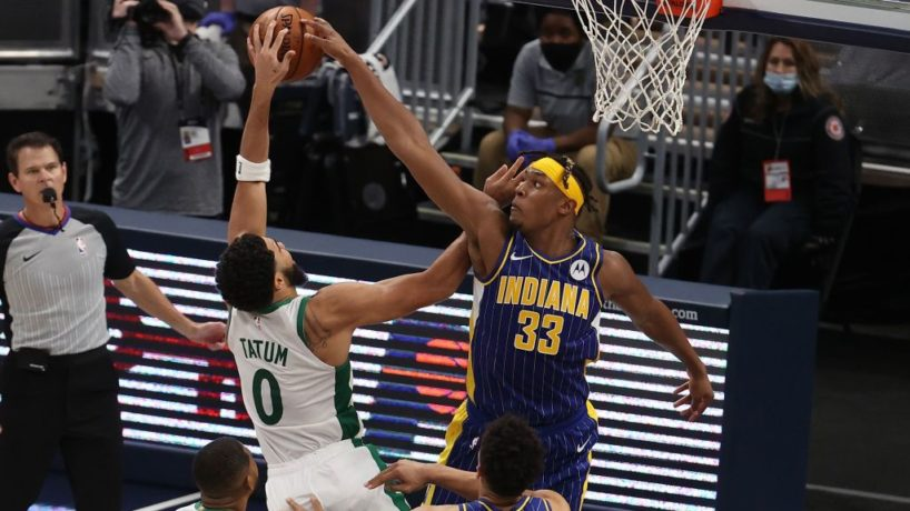 Myles Turner swats away a lay up attempt by Boston's Jayson Tatum in a game at Bankers Life Fieldhouse