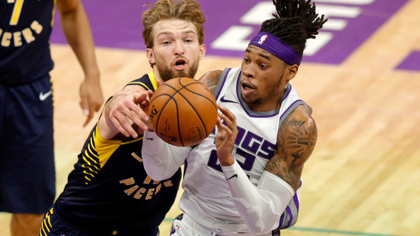 Pacers forward Domantas Sabonis tries to defend a Kings player.