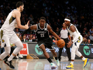Caris LeVert drives to the paint against Pacers big man Goga Bitadze with Aaron Holiday behind the two