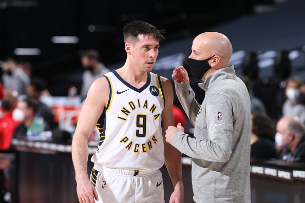 Pacers guard T.J. McConnell talks to Nate Bjorkgren during a win over Portland.