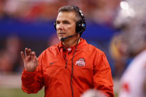 Urban Meyer coaches in the Big Ten Championship at Lucas Oil Stadium with his headset on