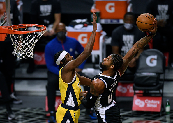 Clippers forward Paul George dunks against his former team.