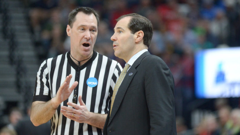 Scott Drew talks to a NCAA referee on the sideline in Baylor's matchup with Gonzaga