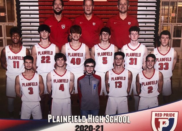 The Plainfield Boys Basketball team poses for a team photo along with their coaches