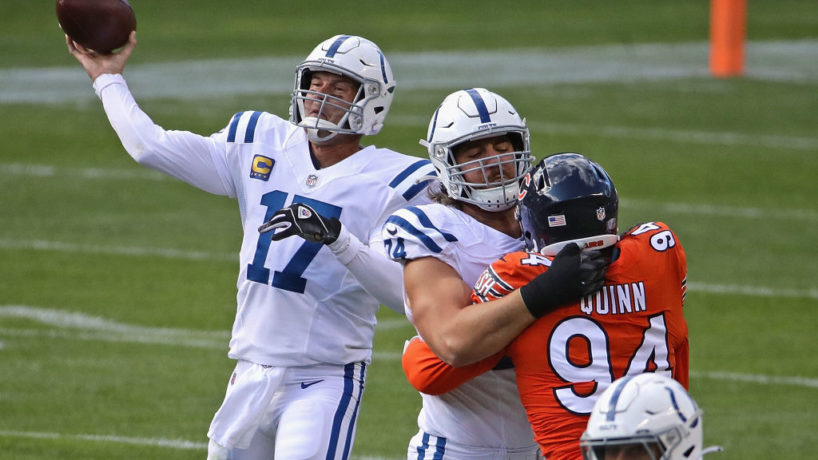 Philip Rivers launches a pass with Anthony Castonzo blocking a Chicago Bears edge rusher in front of him