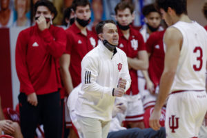 Archie Miller shouts instructions from the Indiana sideline with his bench players behind him