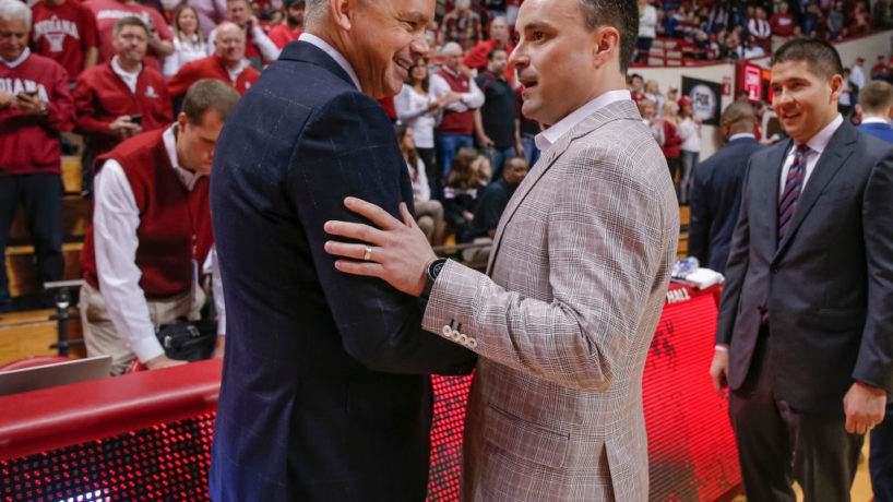 Chris Holtmann and Archie Miller shake hands in front of the scorer's bench before a game between Ohio State and Indiana at Assembly Hall