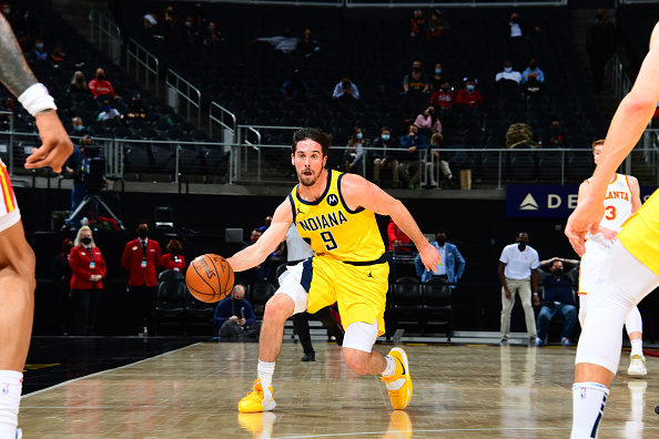 Pacers guard T.J. McConnell makes a pass.