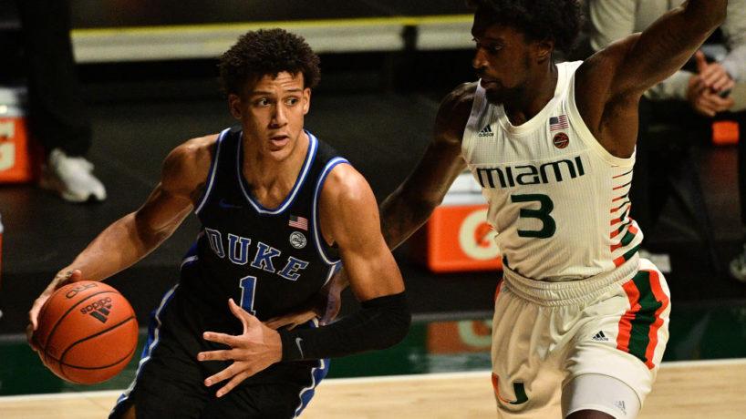 Now-former Duke forward Jalen Johnson drives to the basket against a Miami defender