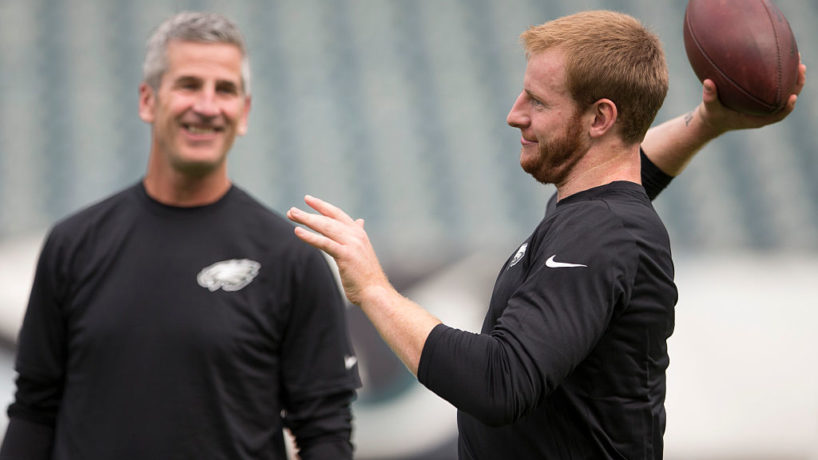 Frank Reich looks on at Carson Wentz.