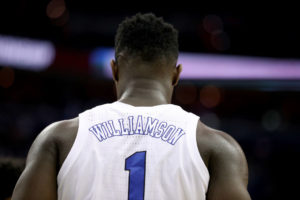 A behind the back shot of Zion Williamson as his #1 Duke jersey is seen