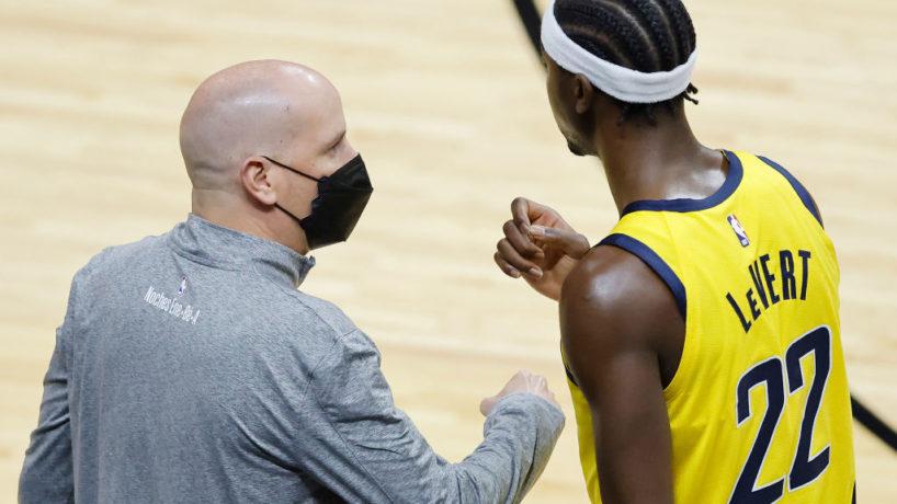 Pacers guard Caris LeVert talks to Nate Bjorkgren.