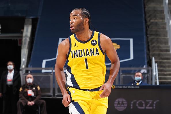 Pacers forward T.J. Warren runs back down the floor.