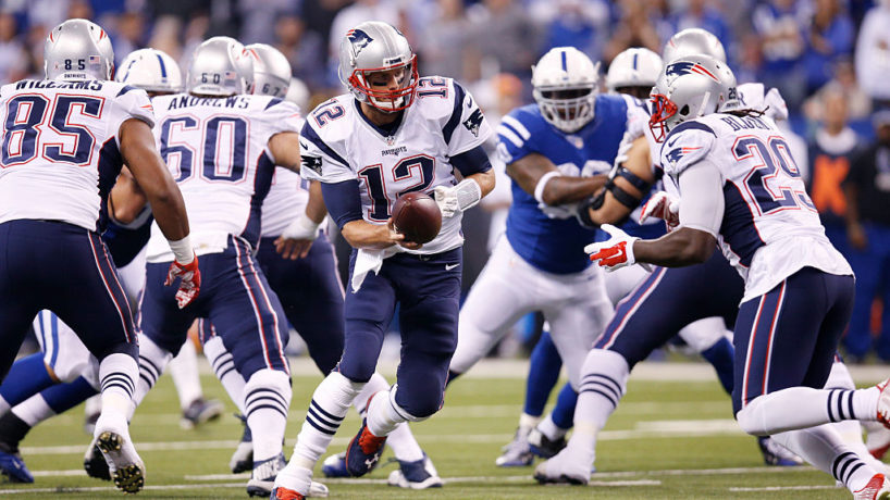 Tom Brady hands the ball off with the Patriots in a matchup with the Indianapolis Colts at Lucas Oil Stadium