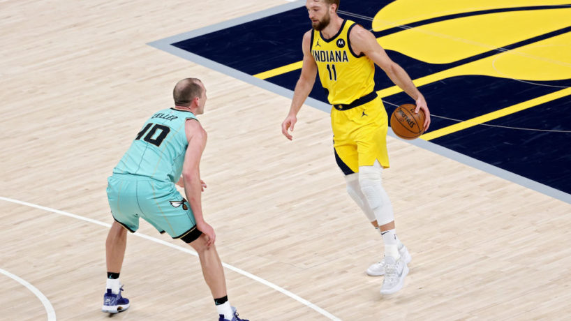 Pacers forward Domantas Sabonis tries to drive in a game.