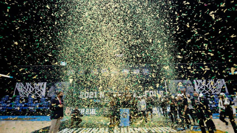 Baylor celebrates on the National Championship floor with confetti falling from above