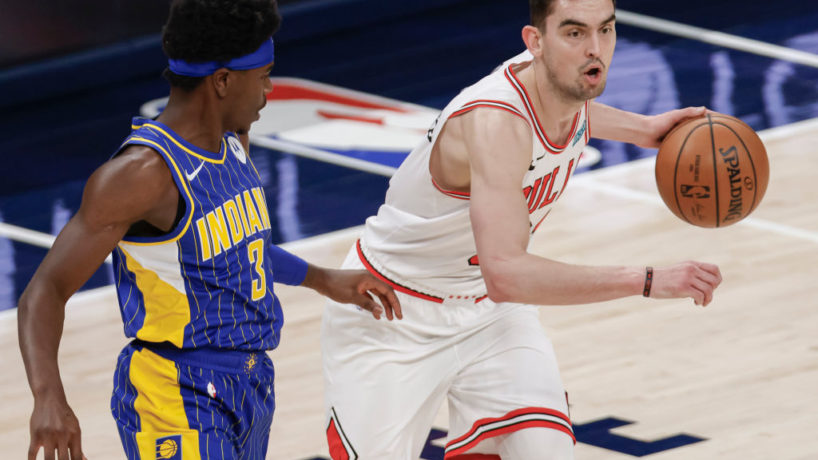 Pacers guard Aaron Holiday defends Chicago's Tomas Satoransky as Indiana takes on the Bulls