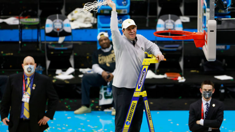 Scott Drew climbs the ladder and cuts down the nets as he waves to the crowd after Baylor beat Gonzaga in the National Championship
