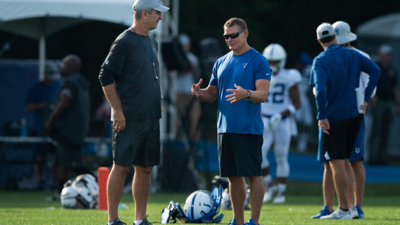 Frank Reich and Chris Ballard talk before practice.