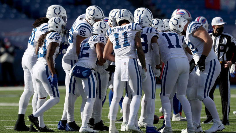 The Colts huddle before a play.