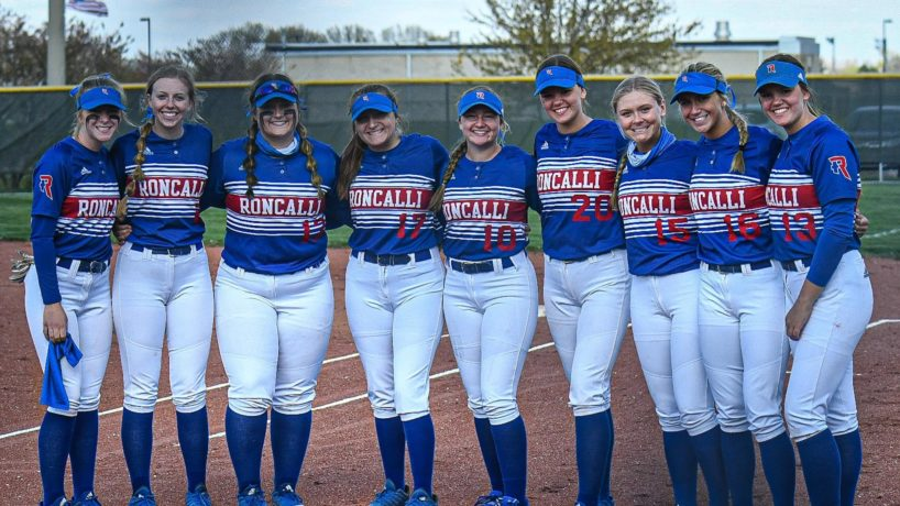 The Roncalli Softball team poses on the field