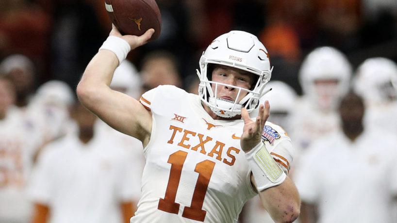 Texas QB-Sam Ehlinger gets ready to throw a ball.