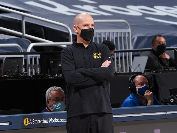 Pacers HC Nate Bjorkgren coaches from the sideline.