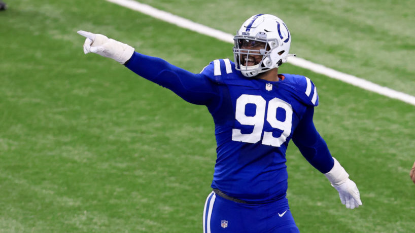 Colts DT-DeForest Buckner points to the crowd in a game.