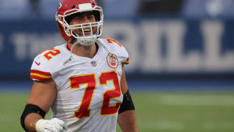 A shot of Eric Fisher smiling on the field as the Chiefs play a game