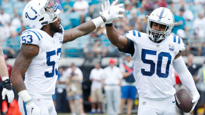 Darius Leonard and Anthony Walker high five each other after a play.