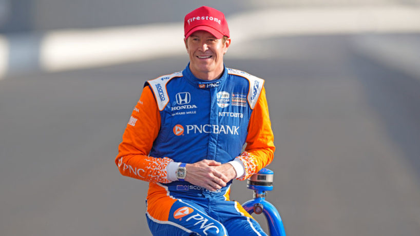 Scott Dixon poses for a photo at the Indianapolis Motor Speedway with his red pole winner hat on