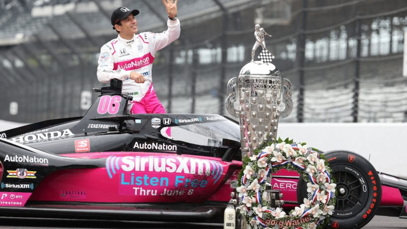 Helio Castroneves poses on top of his car for his Indy 500 win photo shoot at the yard of bricks