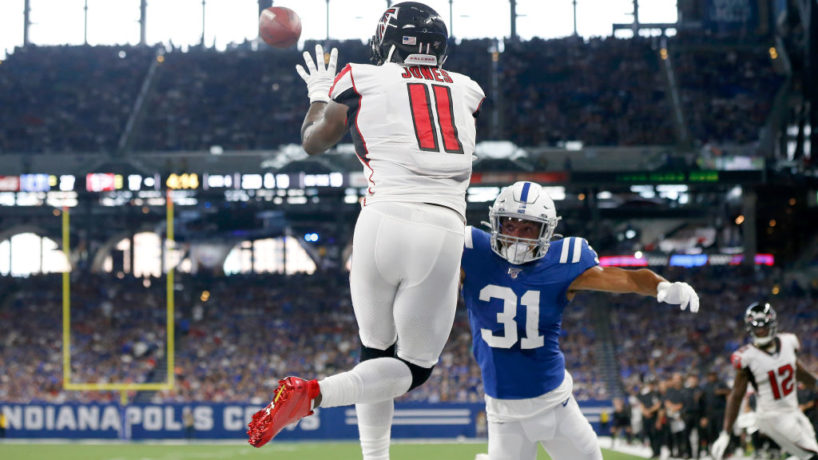 Julio Jones catches a touchdown pass in front of a Colts defender at Lucas Oil Stadium