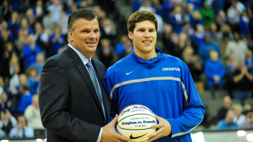 Doug McDermott #3 accepts a ball from his father head coach Greg McDermott of the Creighton Bluejays before the game against the Southern Illinois Salukis at the CenturyLink Center on February 19, 2013 in Omaha, Nebraska.